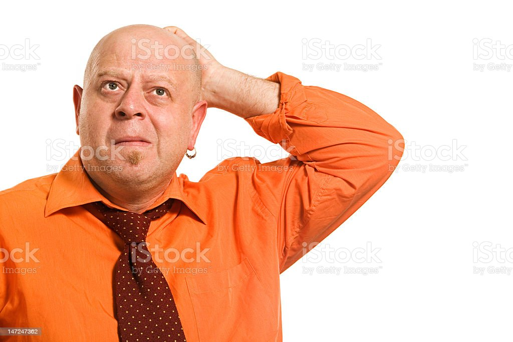 The thoughtful man in an orange shirt royalty-free stock photo