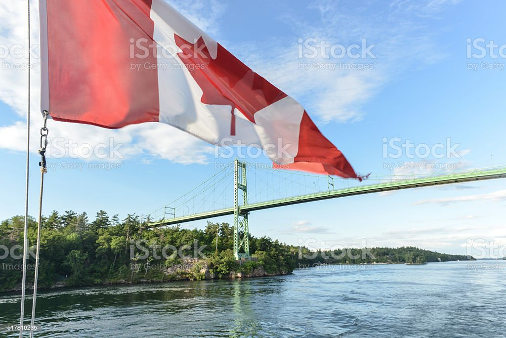 The Thousand Islands Bridge and Canadian Flag stock photo