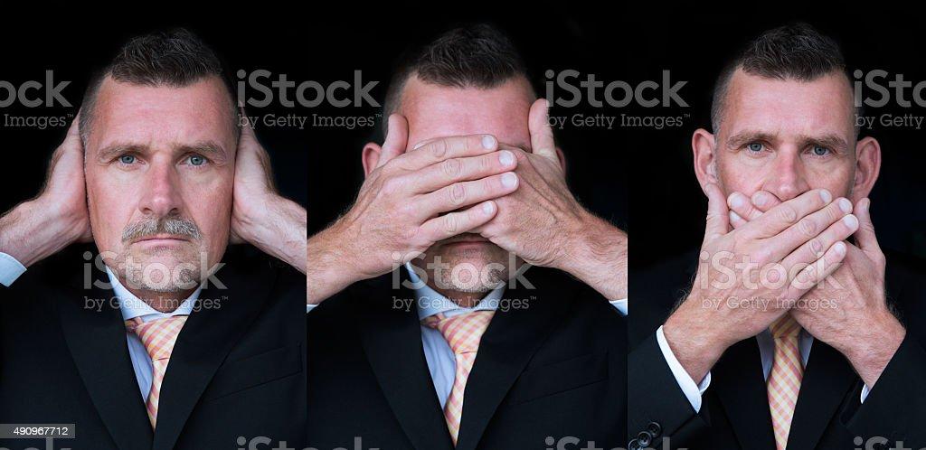 the three wise monkeys- businessman stock photo