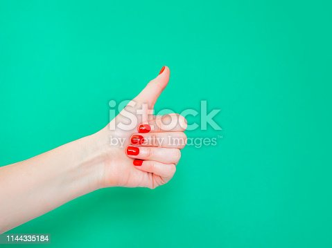 istock The Thumbs Up Sign. Like Hand Sign. Used when you want to demonstrate that you like something or that you approve of something, The ol thumbs up hand sign. Female hand with red manicure on fingernails holding hand in gesture of likeness giving thumb up on 1144335184