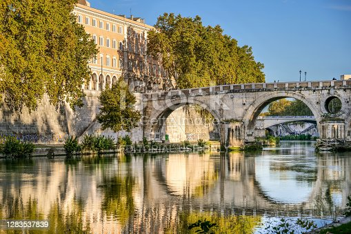 Rome, Italy, October 31 -- The Tiber riverbank and embankment and Ponte Sisto on front the Trastevere quarter, in the heart of Rome. Image in High Definition format.