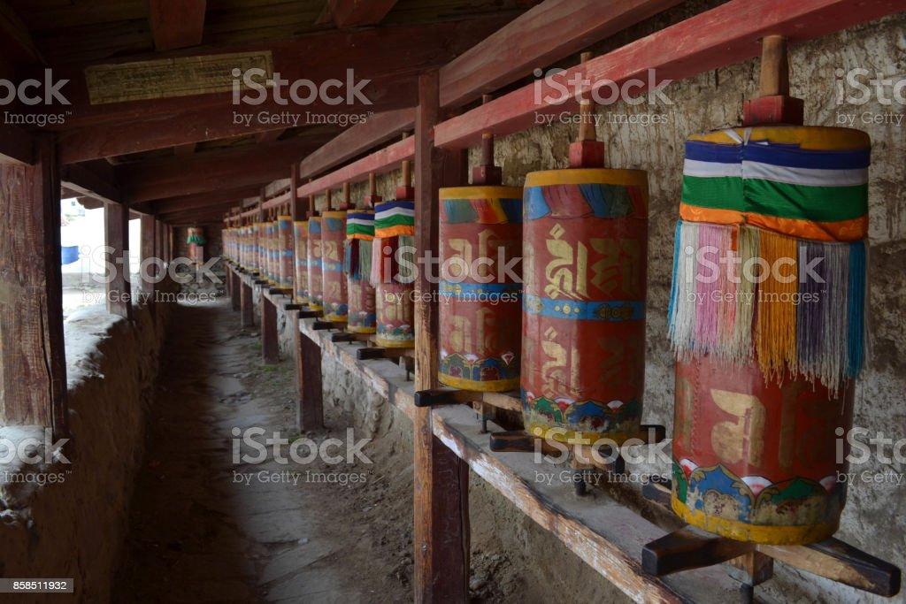 The Tibetan kora or pilgrimage and prayer wheels in Langmusi, Amdo Tibet stock photo