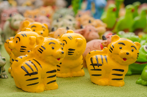 909806032 istock photo The tiger dolls molded from plaster. minimal colorful toys for decoration, home, garden, room and office. 833598250