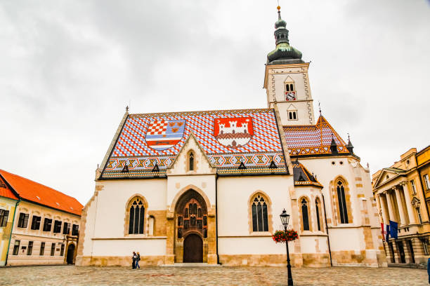 The tile roof of Saint Mark's Church displays the coat of arms of Zagreb and the Triune Kingdom of Croatia, Slavonia and Dalmatia stock photo