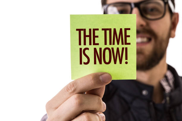 the time is now - urgency stock photos and pictures