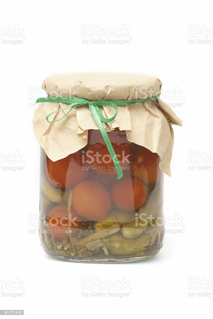 The tinned tomatoes and cucumbers royalty-free stock photo