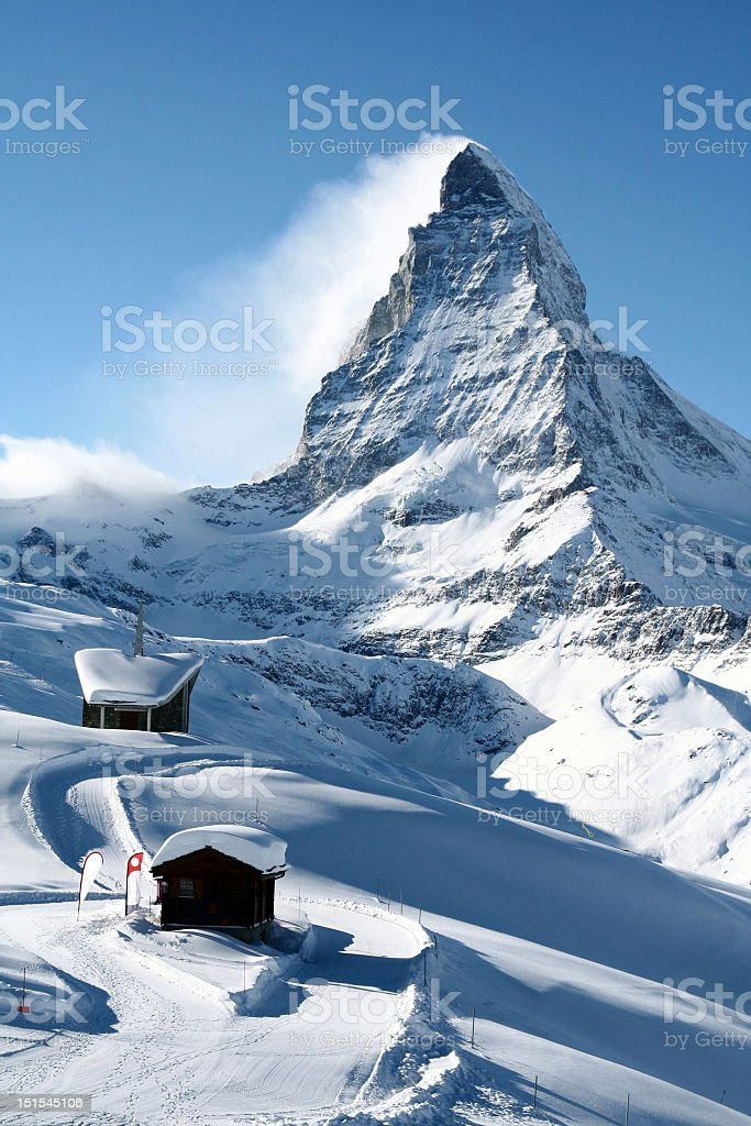 The tip of snow capped Mount Matterhorn in Switzerland stock photo
