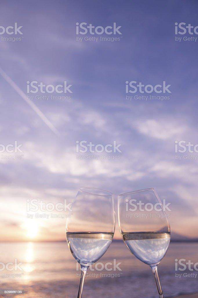 The toast on the beach at dusk stock photo
