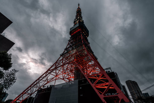 The Tokyo Tower at dawn under a cloudy sky. stock photo