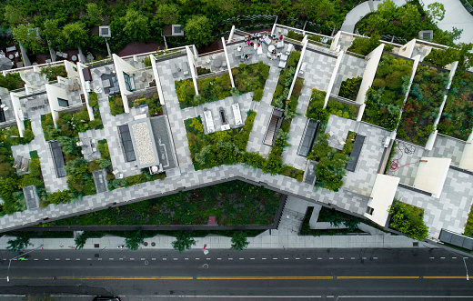 The top directly above view to the modern rooftops with gardens in Brooklyn Heights, at the waterfront nearby Esplanade and Brooklyn Bridge Park