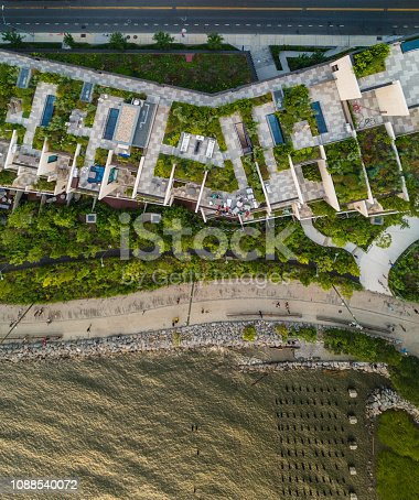 The top directly above view to the modern rooftops with gardens in Brooklyn Heights, on the waterfront nearby Esplanade and Brooklyn Bridge Park at the hot summer evening
