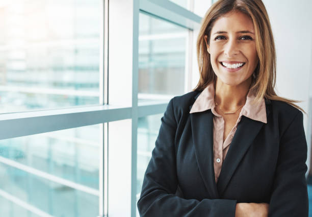 the top is the only place for a managing director - woman suit stock photos and pictures