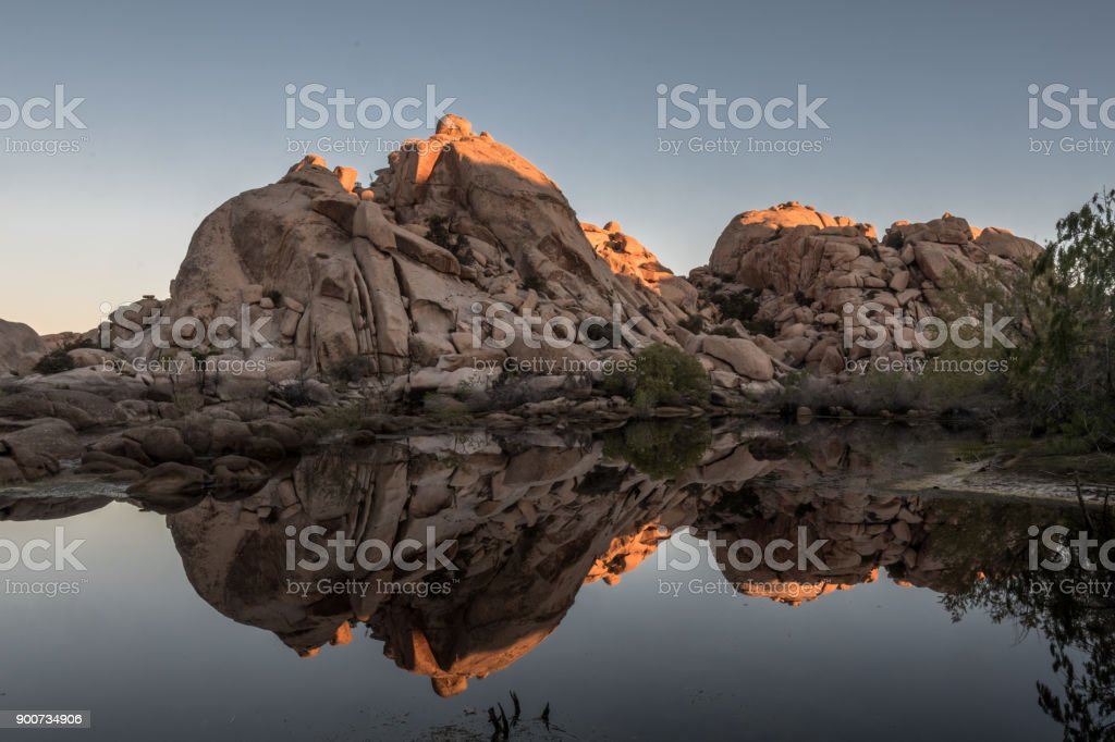 The Top of Barker Dam is Lit Wtih Early Morning Sun stock photo