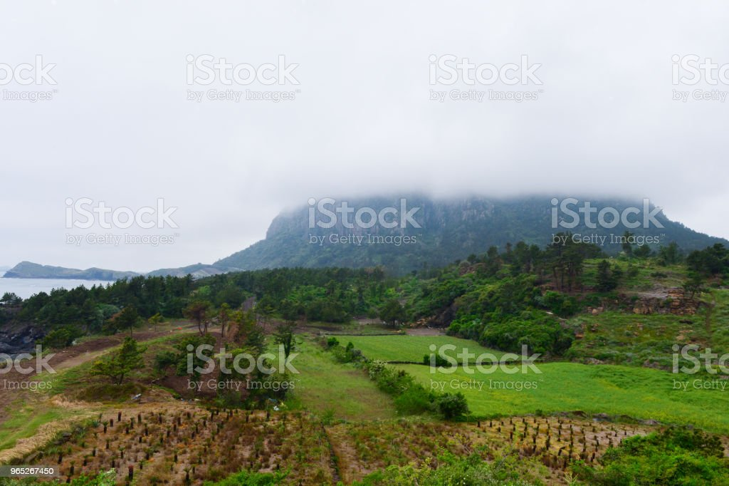 The top of Sanbangsan mountain is covered with heavy clouds after it is rain in the Jejudo island. royalty-free stock photo
