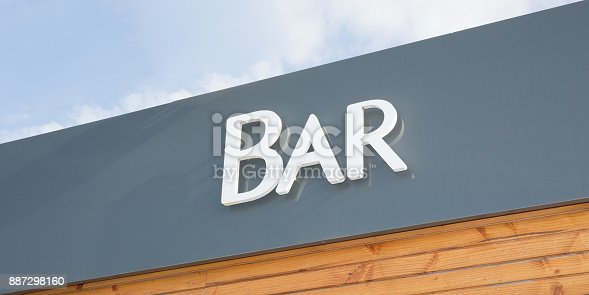 1140718043 istock photo The top of the building with inscribed bar on the wood background 887298160
