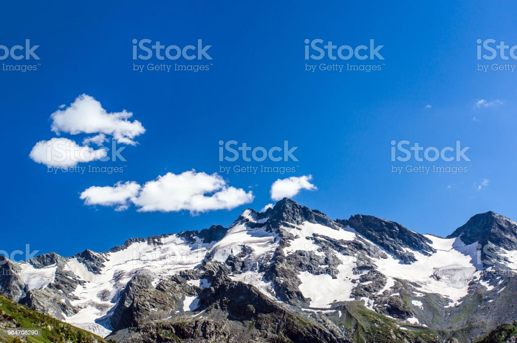 The top of the mountain on the background of blue sky royalty-free stock photo