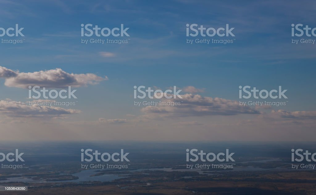 The top view from a window of the flying plane on the city from airplane earth from height stock photo