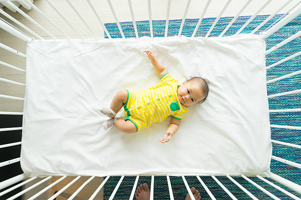 the top view of baby in cot, cradle stock photo