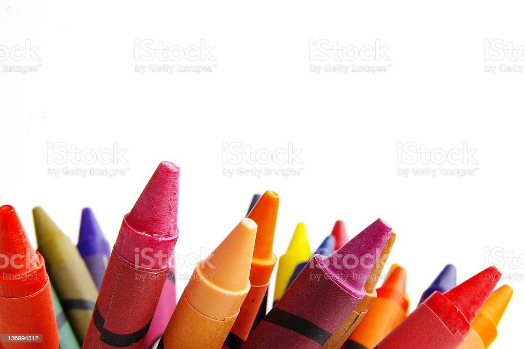 The tops of crayons against a white background stock photo