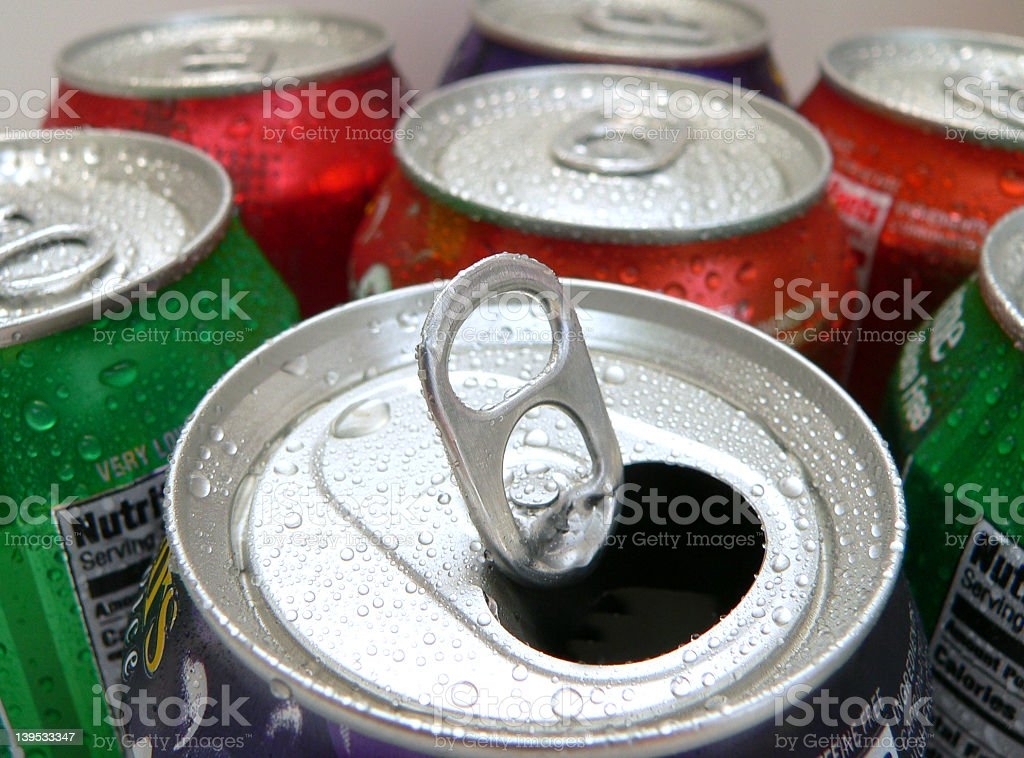 The tops of soda cans open and closed stock photo
