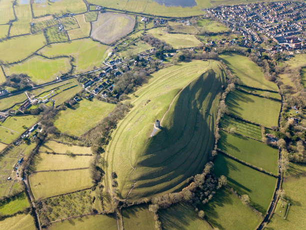 The Tor at Glastonbury High angle aerial shot of the Tor taken from the eastern end with a UAV somerset england stock pictures, royalty-free photos & images