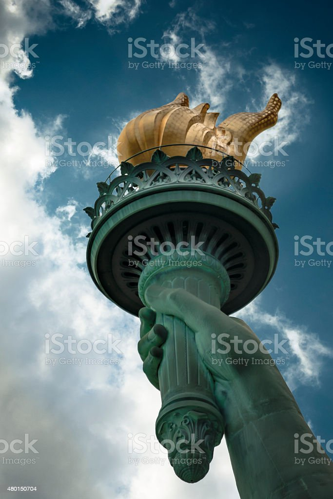 The torch of the Statue of Liberty on a cloudy day stock photo