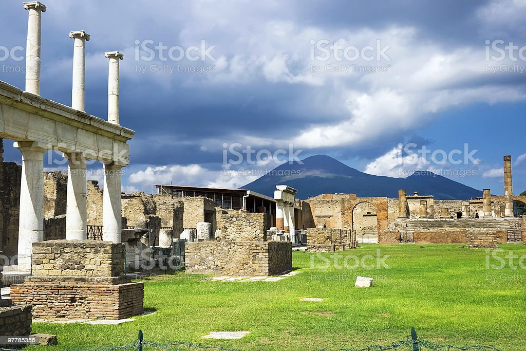 The torn down town of Pompeii under a blue sky stock photo