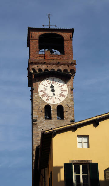 The Torre delle Ore tower in Lucca, Italy stock photo