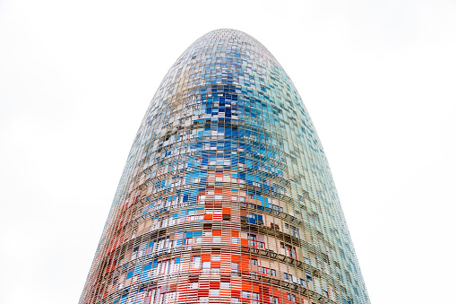 The Torre Glories, formerly known as Torre Agbar in a beautiful autumn light in Barcelona, Spain