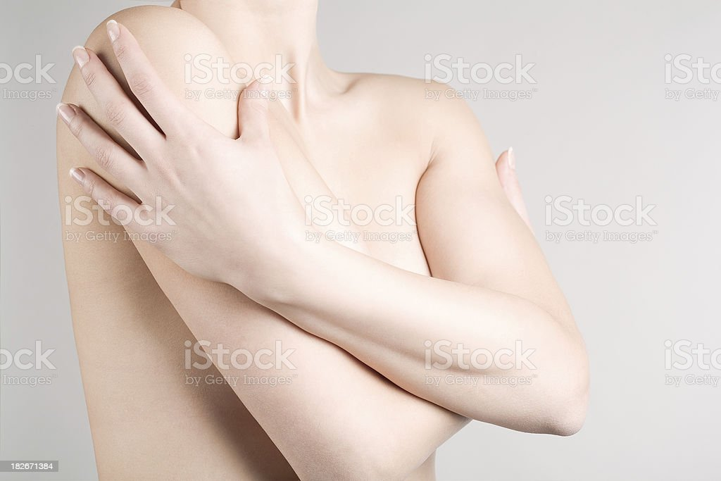 The torso of a woman wrapping her hands around her body royalty-free stock photo