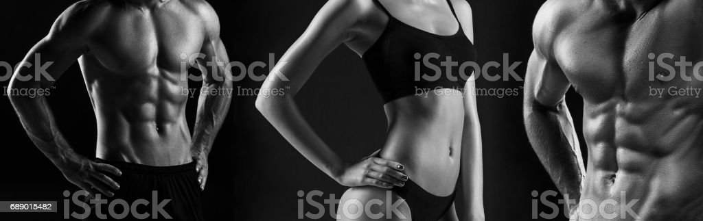 The torso of attractive male and female bodys on black background stock photo