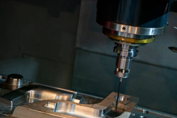 The touching probe attach with the spindle of CNC milling machine for on the machine measuring process. The touching probe attach with the spindle of CNC milling machine for on the machine measuring process. The mold quality control processing on the 3 axis machining center with touching probe. dimensionality stock pictures, royalty-free photos & images