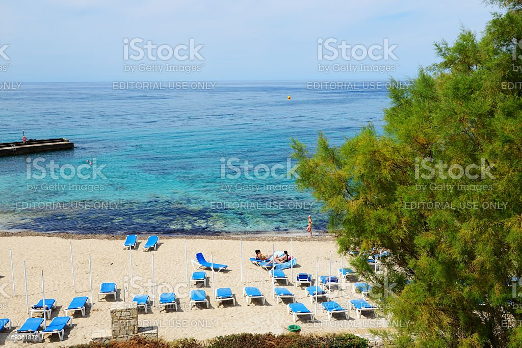 The tourists enjoiying their vacation on beach stock photo