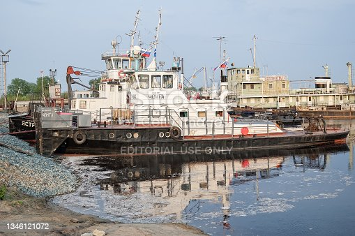 istock The tow is moored to the river bank Tura. Tyumen 1346121072