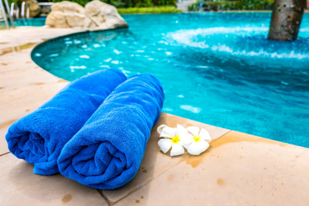 The towel is placed by the pool. The towel is placed by the Swimming Pool poolside stock pictures, royalty-free photos & images