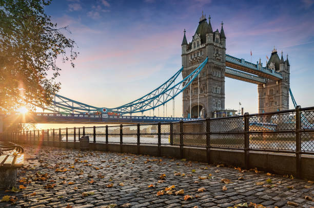 The Tower Bridge in London during a golden sunrise The Tower Bridge in London, United Kingdom, during a golden sunrise london england stock pictures, royalty-free photos & images