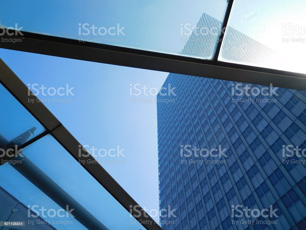 The tower building under the blue sky through glassed roof stock photo