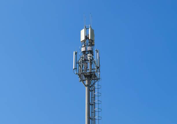 the tower cell tower with transponders. communication technologi - emissione radio televisiva foto e immagini stock