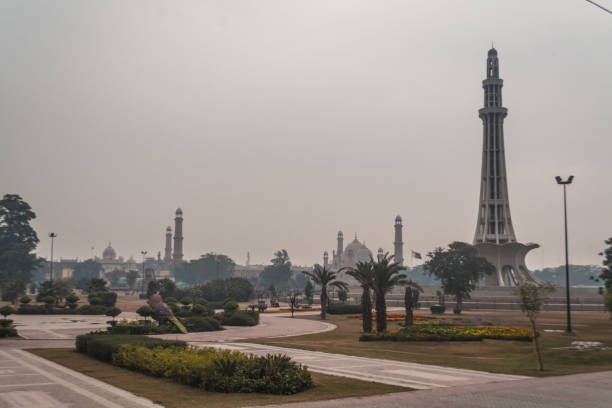 The tower of Minar-e-Pakistan Urdu: مینارِ پاکستان Minar-e-Pakistan (Urdu: مینارِ پاکستان) is a national monument located in Lahore, Pakistan. The tower was built between 1960 and 1968 on the site where the All-India Muslim League passed the Lahore Resolution on 23 March 1940 - the first official call for a separate and independent homeland for the Muslims of British India, as espoused by the two-nation theory. The resolution eventually helped lead to the emergence of an independent Pakistani state in 1947. The tower reflects a blend of Mughal/Islamic and modern architecture. lahore pakistan stock pictures, royalty-free photos & images