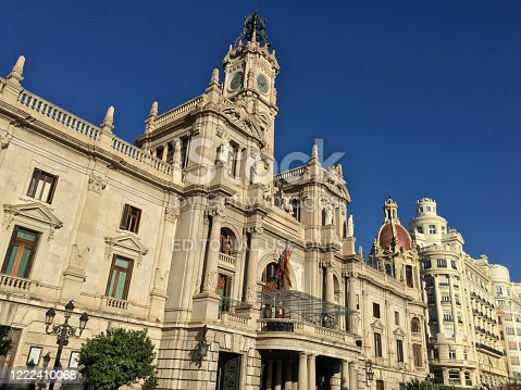 Valencia, Spain - March 02, 2020: Low angle view of the magnificent building of the town hall of the city of Valencia. The City Council has been based there since 1934, and the building also houses the municipal archives, a museum, and various offices of the administration