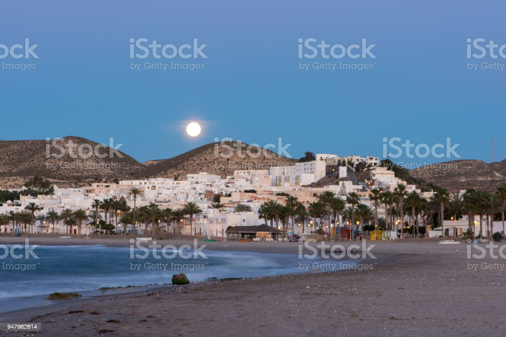 The town of Carboneras de Almeria under the moon stock photo