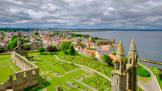 The town of St Andrews seen from the St Rule's tower. You can see the ruins of the Cathedral, built in 1158, and the ruins of the Castle, dating to the 1200s. St Andrews, Fife, Scotland.