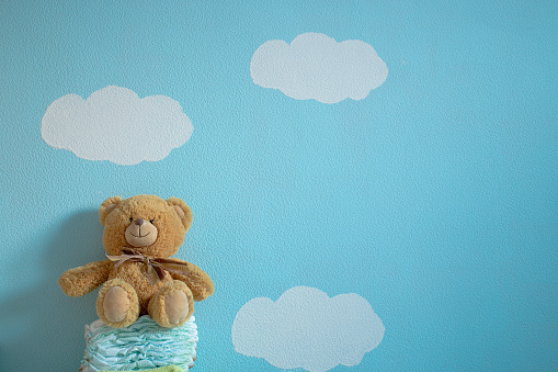 istock The toy is sitting on the diapers 621136226