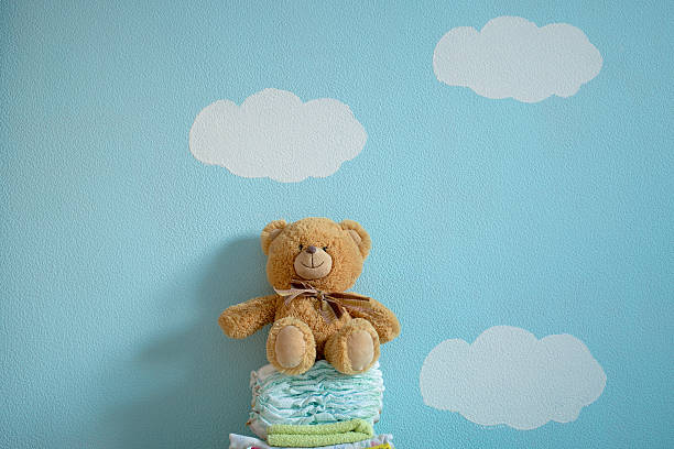 The toy is sitting on the diapers picture id621136274?b=1&k=6&m=621136274&s=612x612&w=0&h=g6k3gsh1go7sdlhc7fm2uksiwxnhmnkafml2kf35yea=
