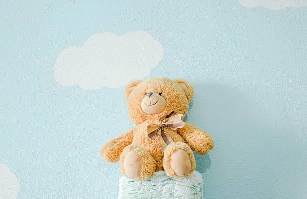 The toy is sitting on the diapers picture id635902938?b=1&k=6&m=635902938&s=612x612&w=0&h=qek5 wmfpnopb5ptt6vqvpmjdwpwmyz95kzqniety4k=