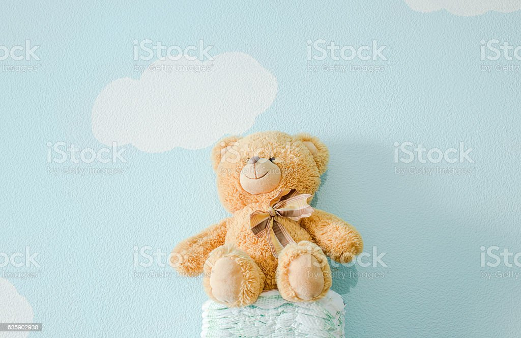 The toy is sitting on the diapers stock photo