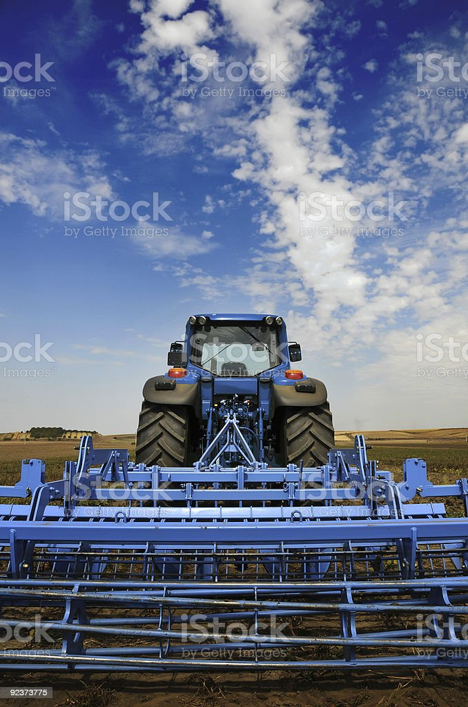 The Tractor - modern farm equipment in field royalty-free stock photo