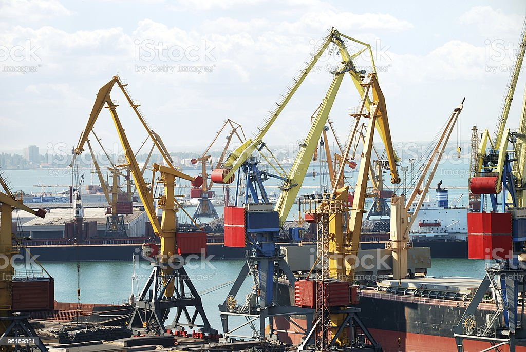 The trading seaport with cranes and ships royalty-free stock photo