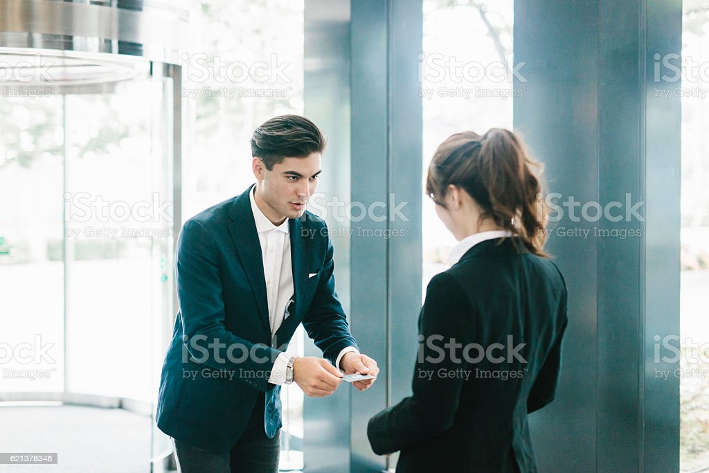 The Traditional Exchanging of a Business Card ストックフォト