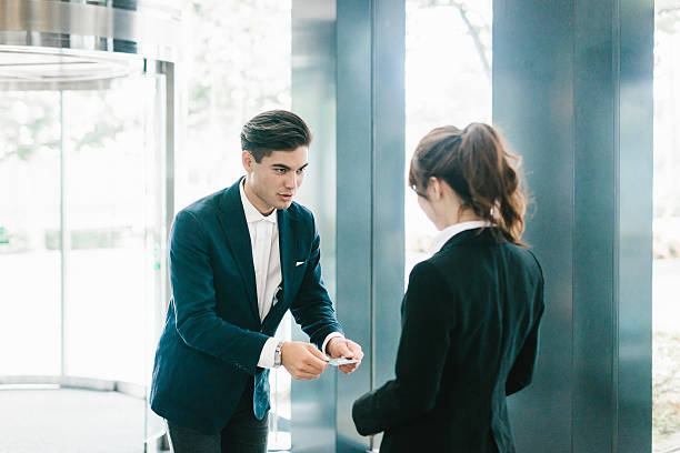 The Traditional Exchanging of a Business Card stock photo